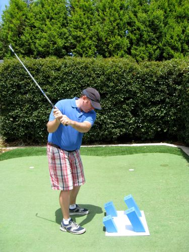 An ideal back swing is short and comfortable